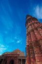 Minaret qutub minar at qutub complex ancient islamic architecture under blue sky india delhi unesco world heritage site Stock Image