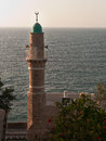 Minaret with sea background blue sunset lighting Royalty Free Stock Images