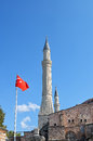 Minarets of Muslim mosque and Turkish flag Royalty Free Stock Photo