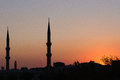 Minarets in silhouette two at sunset istanbul Stock Photo