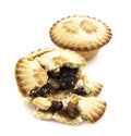 Mince pie broken in half showing on white background Royalty Free Stock Image