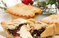 Mince pie closeup of a with cream against a soft focus background Royalty Free Stock Photo
