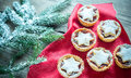 Mince pies with Christmas tree branch Royalty Free Stock Photo