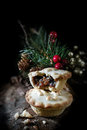 Mince pies ii creatively lit festive christmas or thanksgiving against a dark background in a rustic setting Royalty Free Stock Image