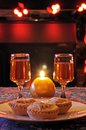 Mince pies and sherry with a candle fireplace to the rear Royalty Free Stock Photography