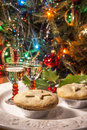 Mince pies and sherry a festive plate of with christmas tree lights Stock Photography
