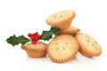 Mince pies with snowflake design and holly berry leaf sprig over white background Stock Photography