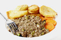 Minced beef and peas dinner high key shot of cooked with onion garlic herbs served with sautee potatoes boiled carrots this is a Stock Image