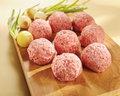 Minced delicatessen meat on a cutting board.