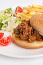 Minced meat burger with fries and salad Royalty Free Stock Image