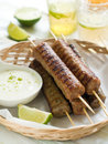 Minced meat kebab with yogurt sauce selective focus Stock Image