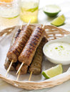 Minced meat kebab with yogurt sauce selective focus Stock Photos