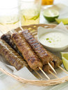 Minced meat kebab with yogurt sauce selective focus Royalty Free Stock Photos