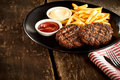 Minced meat stakes with french-fries Royalty Free Stock Photo