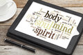 Mind body spirit and soul word cloud on a digital tablet Royalty Free Stock Images