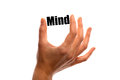 Mind horizontal shot of a hand holding the word between two fingers isolated on white Royalty Free Stock Photo