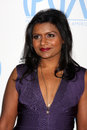 Mindy kaling los angeles jan arrives at the nd annual producers guild awards at beverly hilton hotel on january in beverly hills Stock Photos