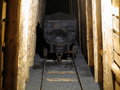 Vintage cart in wooden tunnel at entrance of ore mine Royalty Free Stock Photo