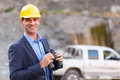 Mine manager binoculars portrait of smiling with visiting mining site Stock Image