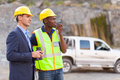 Mine manager worker and visiting mining site Royalty Free Stock Photography