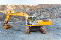 Mine worker excavator operating on mining site Royalty Free Stock Image