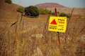 Minefield signboard warning about at golan heights israel Royalty Free Stock Photography