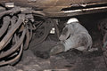 Miner in a mine performs work Stock Image