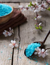 Mineral bath salts, towels and flowers on the old wooden table Royalty Free Stock Photo