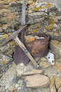 Miners pick bucket shovel rocks skull work concept the tools of the rock quarry miner in the western badlands desert are filthy Royalty Free Stock Photography