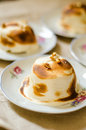 Mini baked alaska cakes ready to be served Stock Photo