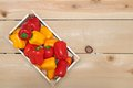 Mini bell pepper peppers in wooden crate Stock Images