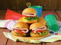 Mini burgers with ham and vegetables Royalty Free Stock Photo