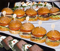 Mini burgers in a row on table from catering Royalty Free Stock Image