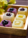 Mini cakes assorted lemon and fruit selective focus Royalty Free Stock Photography