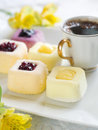 Mini cakes assorted lemon and fruit selective focus Royalty Free Stock Photo