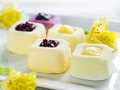 Mini cakes assorted lemon and fruit selective focus Stock Images