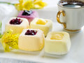 Mini cakes assorted lemon and fruit selective focus Royalty Free Stock Images
