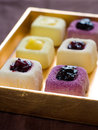 Mini cakes assorted lemon and fruit selective focus Royalty Free Stock Photos