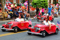 Mini Car Riders in Parade Royalty Free Stock Image