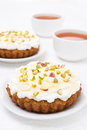 Mini carrot cake with mascarpone honey pistachios and tea black close up vertical Royalty Free Stock Photo