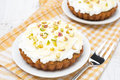 Mini carrot cakes decorated with cream of mascarpone honey and pistachios top view Royalty Free Stock Photo