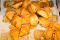 Mini chocolate croissants and chocolate close up. Royalty Free Stock Photo