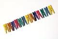 Mini colourful clothes pegs Stockfotos