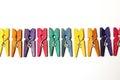 Mini colourful clothes pegs Lizenzfreie Stockbilder