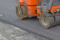 Mini compactor roller during road construction at asphalting work Royalty Free Stock Photos