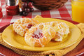 Mini danish a plate of cherry and cheese pastries with orange juice Royalty Free Stock Photos