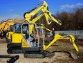 Mini excavators of different sizes Royalty Free Stock Photo