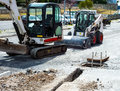 Mini excavators used for implementation of the new network Royalty Free Stock Photo