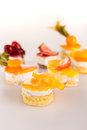 Mini fruit tarts choice creamy desserts Royalty Free Stock Images