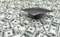 Mini graduation cap on US money - education costs